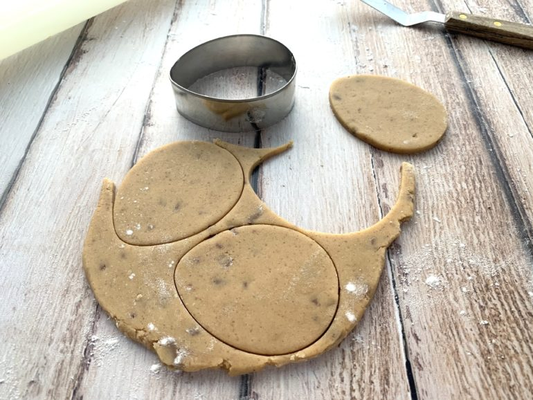Cookies being cut from dough